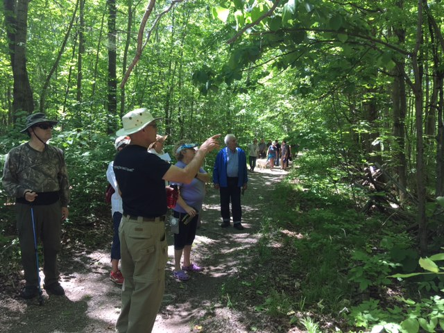 KLT Volunteer Ian Deslauriers pointing out interesting features along the Chase Trails