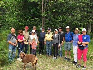Jeremy Carver (centered in yellow) with a group of hikers at the Stony Lake Trails Celebration